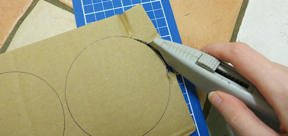 cutting circles out of cardboard