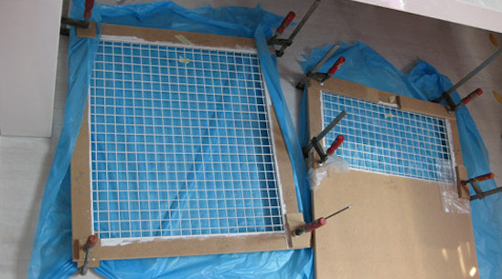 The frame is assembled with glue and clamped to hold it in place whilst the glue dries.