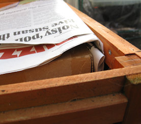 insulate hutch with newspaper